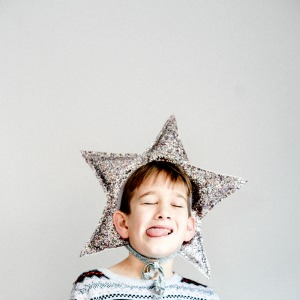 Weird and Shocking History of Homeschooling child wearing a star on the head