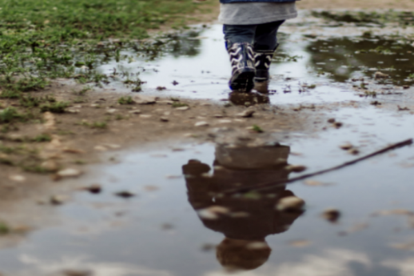#15 IN HOW TO HOMESCHOOL SERIES: Weird and Shocking History of Homeschooling small child's legs stomping in mud puddles
