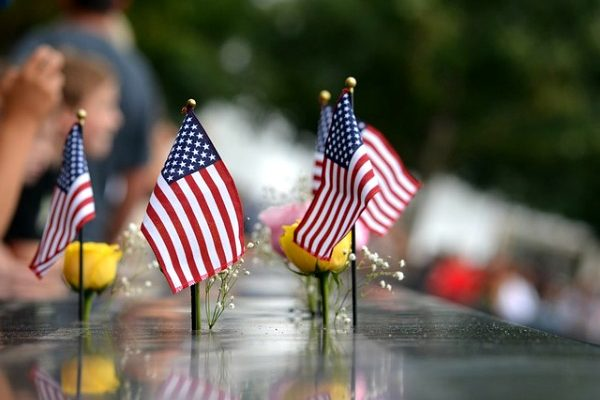 13 Resources on Teaching 9/11 For Kids: Understanding September 11 small American flags on a September 11 memorial