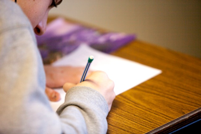 Student taking a test on a desk