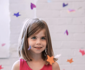 Homeschool Standardized Testing Benefits smiling girl with confetti flying around her