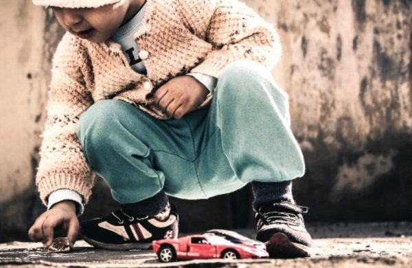 Homeschooling vs Public School: Which Is Better?: small child playing on the ground with toy cars