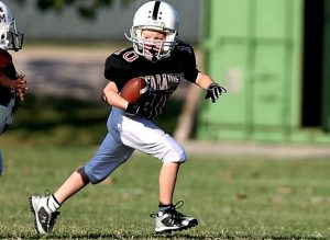 "What Is The Tim Tebow Homeschool Law  (""Equal Access"")? boy in a football uniform playing football"