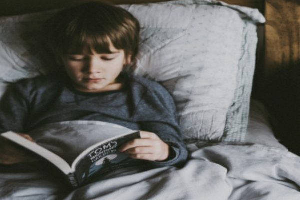 Why Do People Homeschool? Top 19 Reasons for Homeschooling boy reading in bed