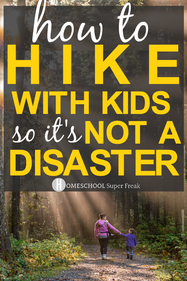 12 Must-Have Items For Hiking With Kids text over a mom and child hiking in the woods