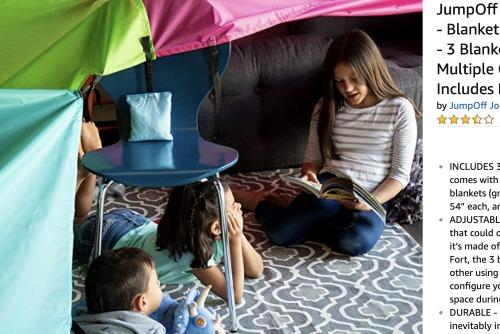 Sleepover Ideas Indoor Blanket Fort kids reading inside of a blanket fort