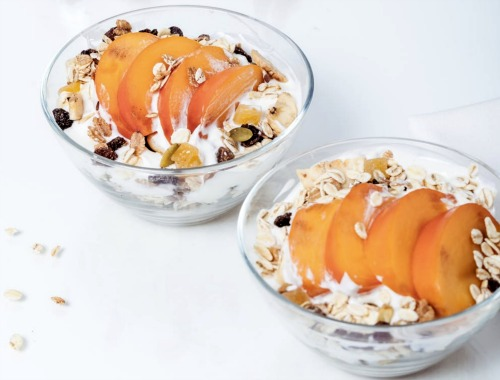 Sleepover Food Ideas for Kids cereal and milk in a bowl with fresh peaches on top