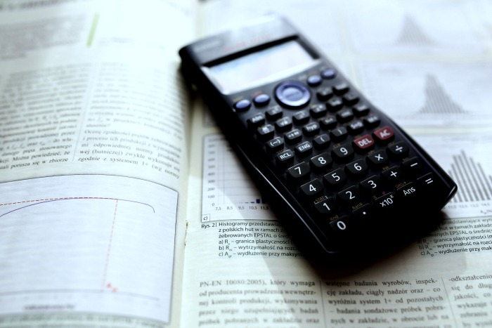 Free Online Scientific Calculator and 2019 Guide to Science Calculators for Students science calculator on top of an open geometry textbook